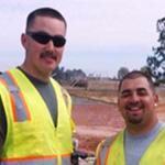 men in construction vests